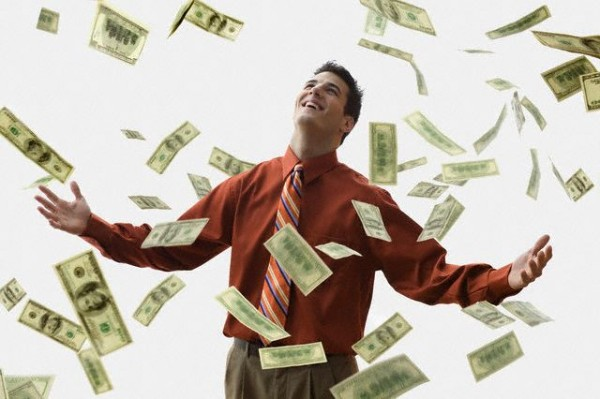 Money Falling on Happy Businessman