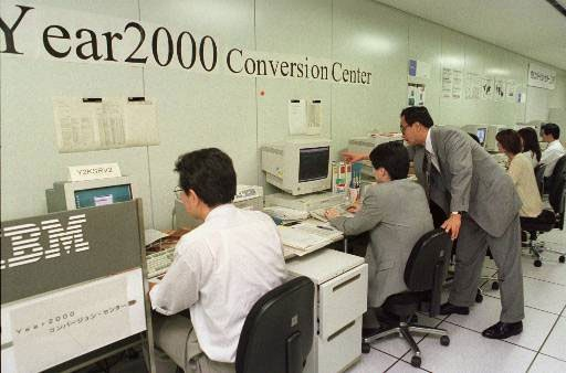 A Y2K conversion center in Japan, with corporations helping programmers to turn over their software systems to compatibility with the new year.