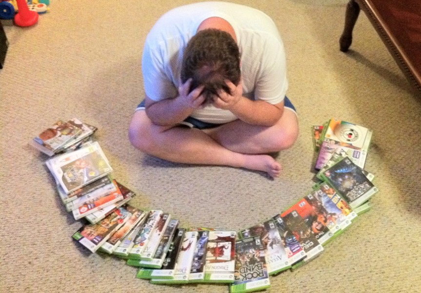 sad gamer too many games