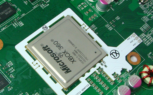 """The current chip inside the """"Corona"""" revision Xbox 360 consoles. Everything is stuck underneath that tiny heatsink!"""