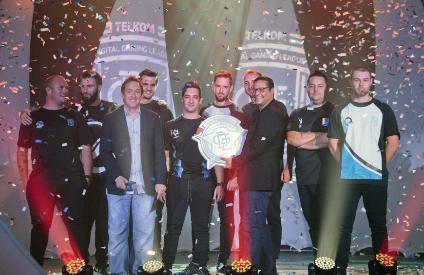 8 clan leads with Paul Chaloner; Telkom's Chief Marketing Officer Enzo Scarcella with official league trophy.